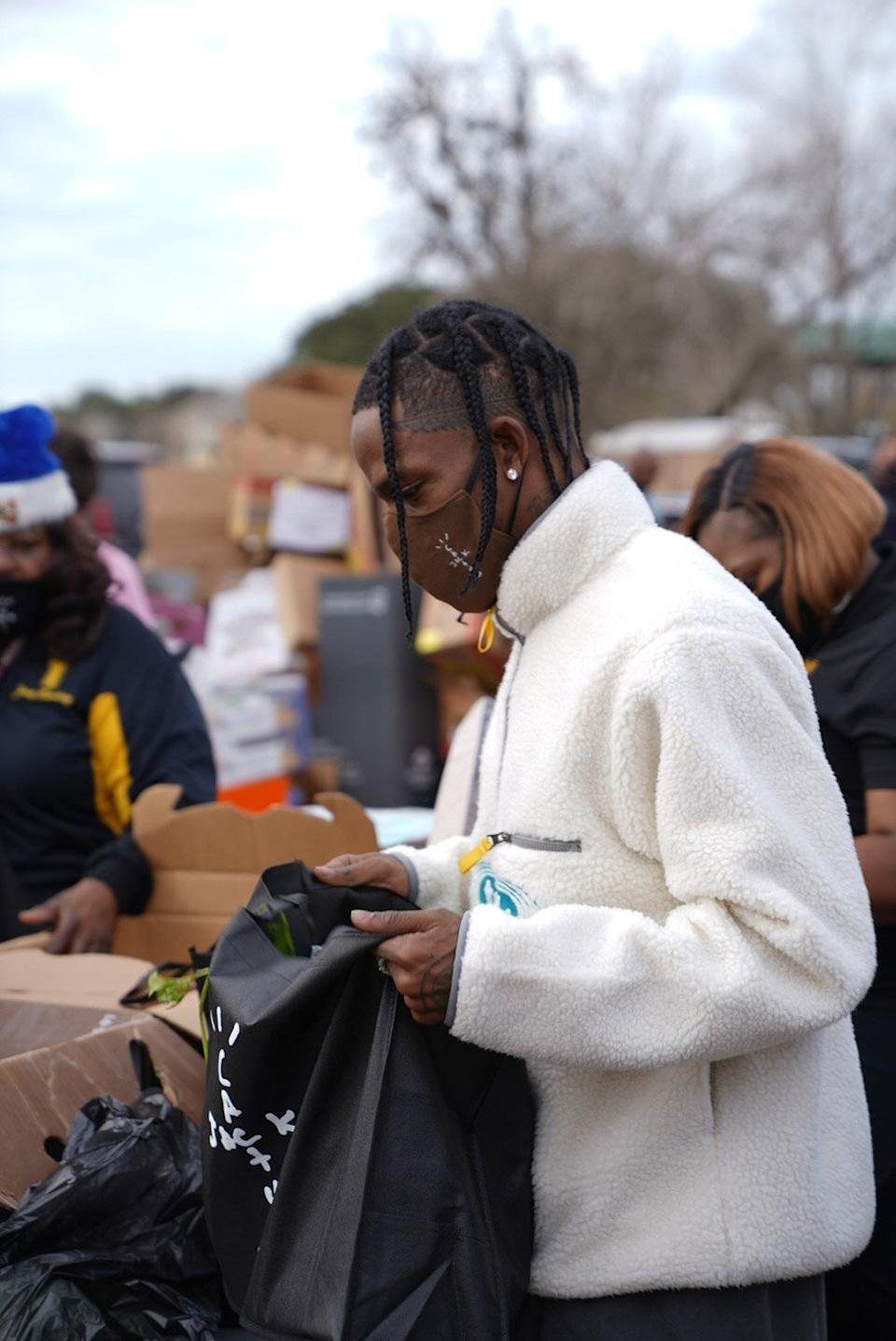 Travis Scott Hosts Toy Drive in Houston — and Kylie Jenner Captures Stormi ' Supporting Her Daddy'