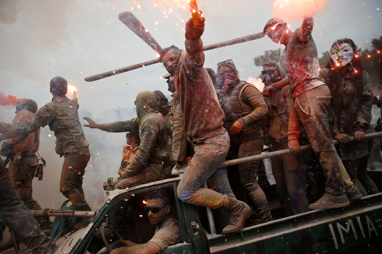 """Revellers celebrate """"Ash Monday"""" by participating in a colourful """"flour war"""", a traditional festivity marking the end of the carnival season and the start of the 40-day Lent period until the Orthodox Easter, in the port town of Galaxidi, Greece, February 19, 2018. REUTERS/Alkis Konstantinidis     TPX IMAGES OF THE DAY"""