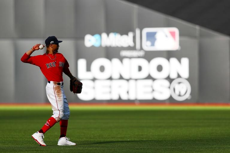Former Boston Red Sox star Mookie Betts throws a ball during last year's MLB games in London, where a planned two-game series involving the St. Louis Cardinals and Chicago Cubs for this year has been called off