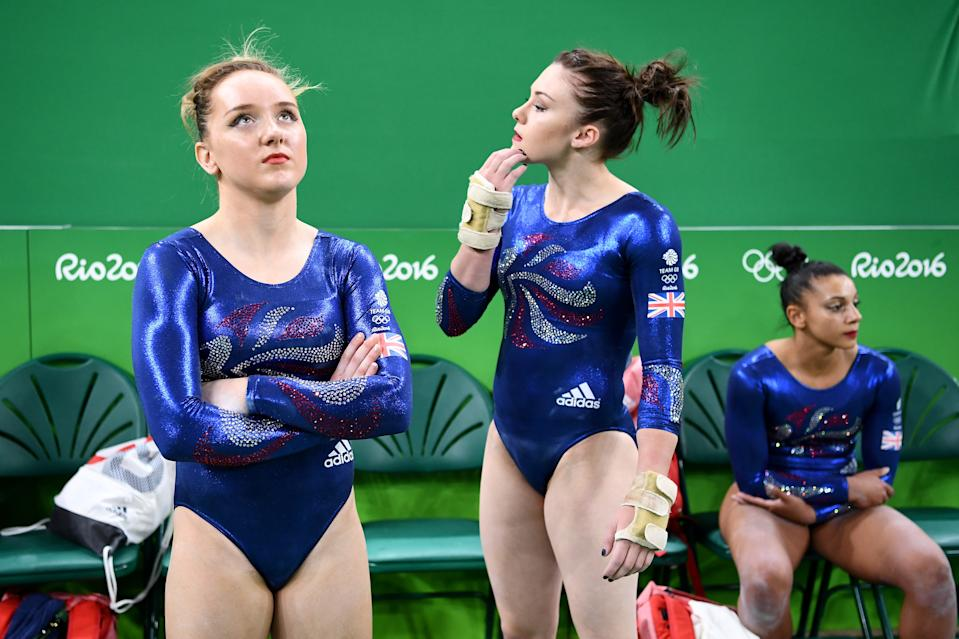 RIO DE JANEIRO, BRAZIL - AUGUST 07: Amy Tinkler (L) and Ruby Harrold (R) of Great Britain look after Elissa Downie was injured and taken off during their floor apparatus during Women's qualification for Artistic Gymnastics on Day 2 of the Rio 2016 Olympic Games at the Rio Olympic Arena on August 7, 2016 in Rio de Janeiro, Brazil. (Photo by David Ramos/Getty Images)