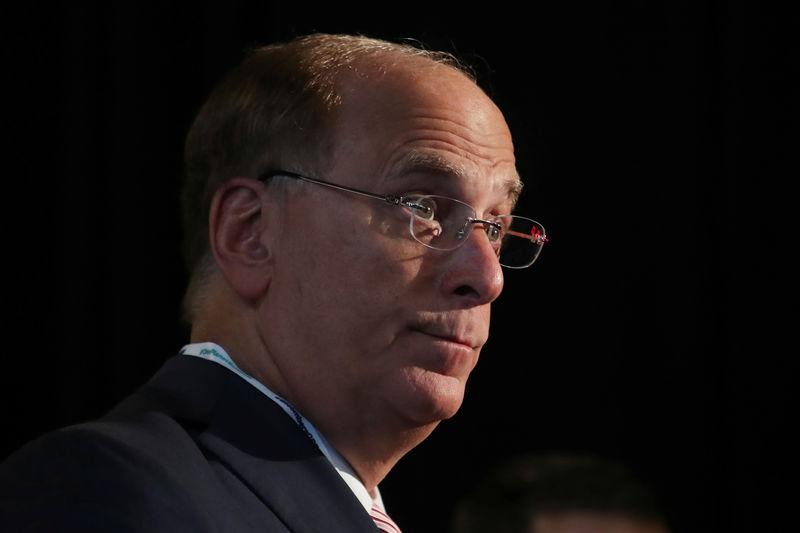 FILE PHOTO: Larry Fink, Chief Executive Officer of BlackRock, stands at the Bloomberg Global Business forum in New York