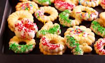 """<p>Simple, small and buttery, Scandanavian spritz cookies can be made in a variety of festive holiday shapes and colors using a special cookie press. They're the perfect addition to any cookie platter filled with more of the <a href=""""https://www.thedailymeal.com/cook/our-50-best-cookie-recipes-slideshow?referrer=yahoo&category=beauty_food&include_utm=1&utm_medium=referral&utm_source=yahoo&utm_campaign=feed"""" rel=""""nofollow noopener"""" target=""""_blank"""" data-ylk=""""slk:best cookie recipes"""" class=""""link rapid-noclick-resp"""">best cookie recipes</a>.<br><br><em><a href=""""https://www.thedailymeal.com/recipes/spritz-cookies-recipe?referrer=yahoo&category=beauty_food&include_utm=1&utm_medium=referral&utm_source=yahoo&utm_campaign=feed"""" rel=""""nofollow noopener"""" target=""""_blank"""" data-ylk=""""slk:For the Spritz Cookies recipe, click here."""" class=""""link rapid-noclick-resp"""">For the Spritz Cookies recipe, click here.</a></em></p>"""