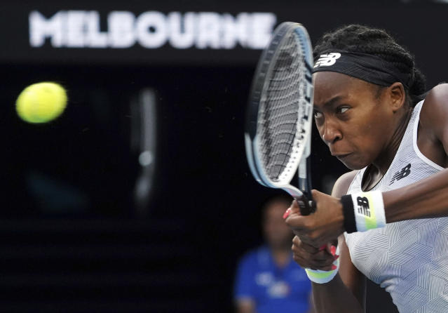 Coco Gauff of the U.S. makes a backhand return to Japan's Naomi Osaka during their third round singles match at the Australian Open tennis championship in Melbourne, Australia, Friday, Jan. 24, 2020. (AP Photo/Lee Jin-man)