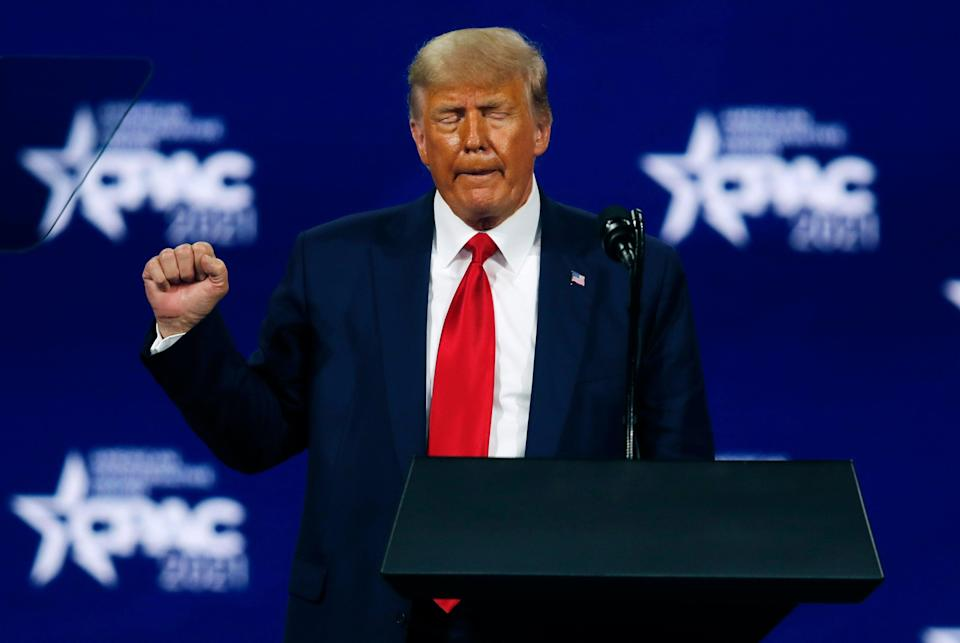<p>Trump claims total credit for vaccines almost exactly a year after saying Covid would disappear 'like a miracle'</p> (REUTERS)