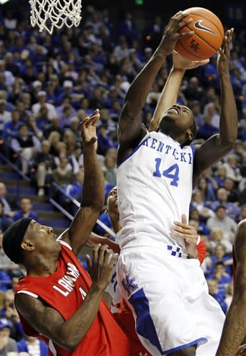 Kentucky's Michael Kidd-Gilchrist (14) shoots over Lamar's Devon Lamb during the second half of an NCAA college basketball game in Lexington, Ky., Wednesday, Dec. 28, 2011. Kentucky won 86-64. (AP Photo/James Crisp)