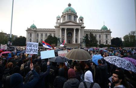 Protesters take part in a demonstration against the overwhelming victory of Prime Minister Aleksandar Vucic in Serbia's presidential election in Belgrade, Serbia April 5, 2017. REUTERS/Djordje Kojadinovic