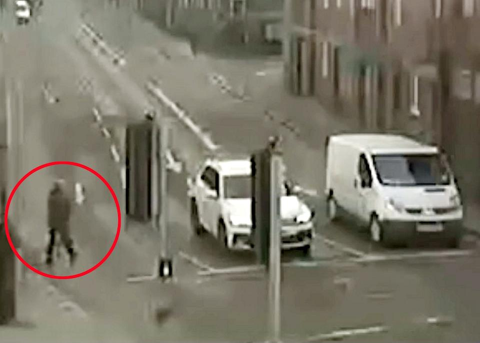 Steven Partington crouched behind the woman's seat before she spotted him in her rear-view mirror (swns)