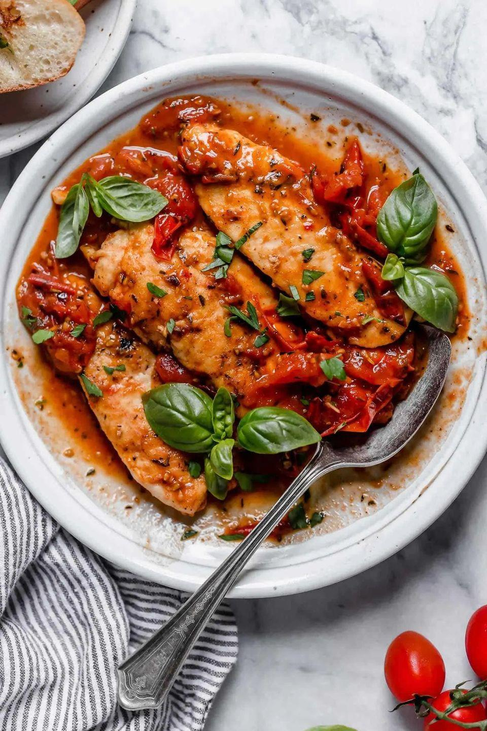 """<p>The key to this pan sauce is making an herb butter with garlic, Italian seasoning, and paprika. It melts into the charred, juicy tomatoes for an incredibly flavorful sauce. </p><p><strong>Get the recipe at <a href=""""https://www.tablefortwoblog.com/chicken-with-tomato-herb-pan-sauce/"""" rel=""""nofollow noopener"""" target=""""_blank"""" data-ylk=""""slk:Table for Two Blog"""" class=""""link rapid-noclick-resp"""">Table for Two Blog</a>. </strong></p><p><a class=""""link rapid-noclick-resp"""" href=""""https://go.redirectingat.com?id=74968X1596630&url=https%3A%2F%2Fwww.walmart.com%2Fsearch%2F%3Fquery%3Dmixing%2Bspoons&sref=https%3A%2F%2Fwww.thepioneerwoman.com%2Ffood-cooking%2Fmeals-menus%2Fg36500577%2Ftomato-recipes%2F"""" rel=""""nofollow noopener"""" target=""""_blank"""" data-ylk=""""slk:SHOP MIXING SPOONS"""">SHOP MIXING SPOONS</a></p>"""