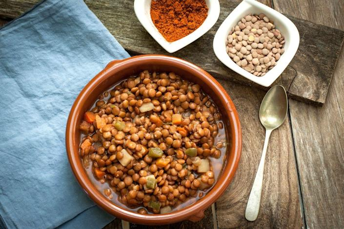 """<p>Lentils are an easy and inexpensive way to get a bunch of fiber (and <a href=""""https://www.prevention.com/food-nutrition/healthy-eating/a20514733/high-protein-vegetables-and-plant-based-food/"""" rel=""""nofollow noopener"""" target=""""_blank"""" data-ylk=""""slk:quality plant-based protein"""" class=""""link rapid-noclick-resp"""">quality plant-based protein</a>) at once. Cording notes that you can get about 6 grams of fiber in a half cup of lentils, which will help keep your digestive system moving—not to mention, keep you feeling full and satisfied.</p>"""