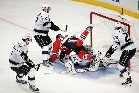 May 18, 2014; Chicago, IL, USA; Chicago Blackhawks center Jonathan Toews (19) falls over Los Angeles Kings goalie Jonathan Quick (32) after the puck went into the net during the second period in game one of the Western Conference Final of the 2014 Stanley Cup Playoffs at United Center. The goal was disallowed due to goaltender interference. Jerry Lai-USA TODAY Sports