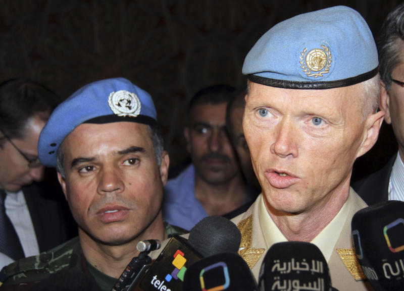 Norwegian Maj. Gen. Robert Mood, head of the U.N. observer team in Syria, right, speaks to reporters after his arrival in Damascus, Sunday, April 29, 2012, as Col. Ahmed Himmiche, left, looks on. Under the peace plan, the U.N. is to deploy as many as 300 truce monitors. One hundred should be in the country by mid-May, and the head of the observer team, Norwegian Maj. Gen. Robert Mood, arrived in Damascus on Sunday to assume command, according to the mission's spokesman, Neeraj Singh.(AP Photo/Bassem Tellawi)