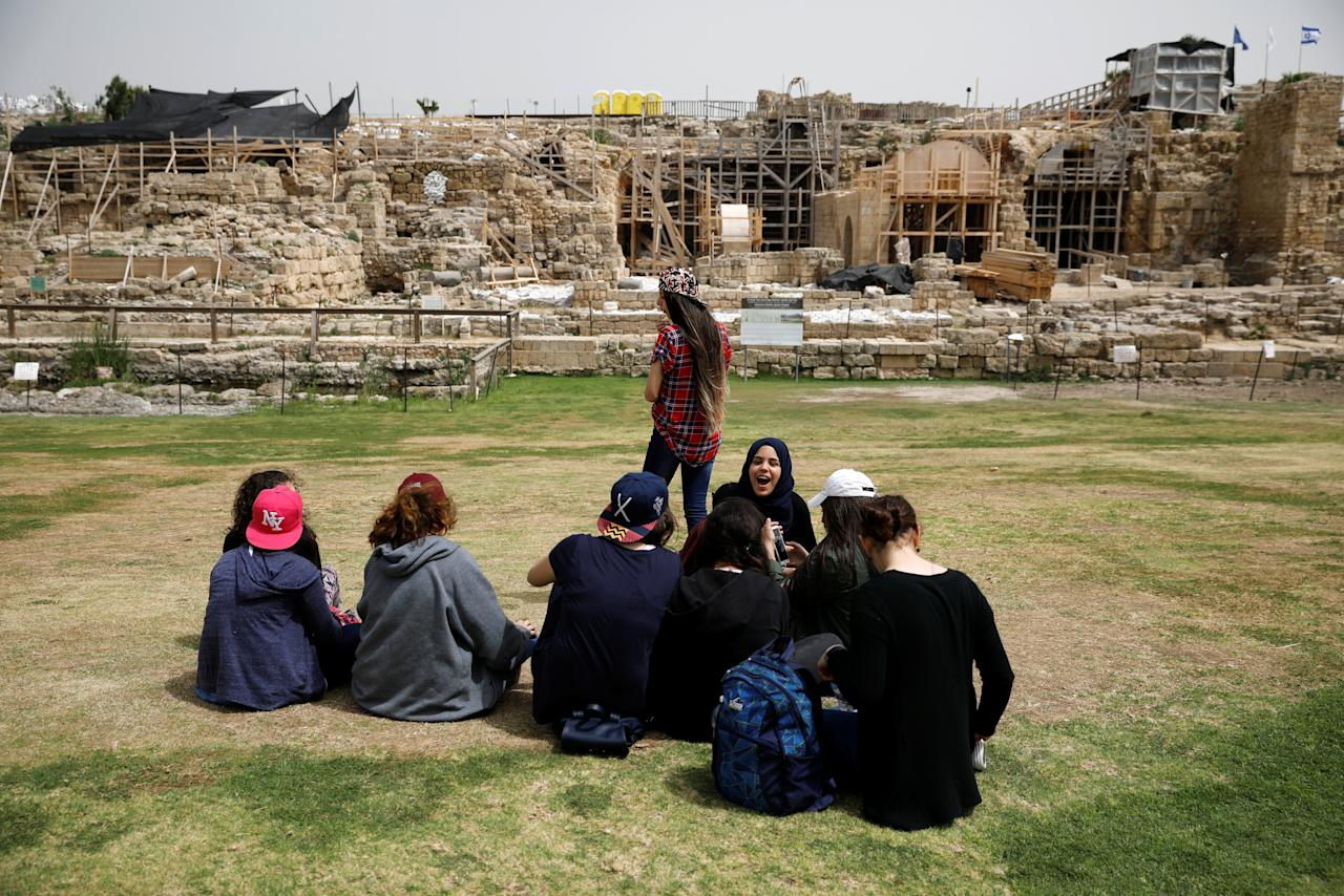 Tourists sit around the site of the old city of Caesarea, Israel April 26, 2017. REUTERS/Amir Cohen