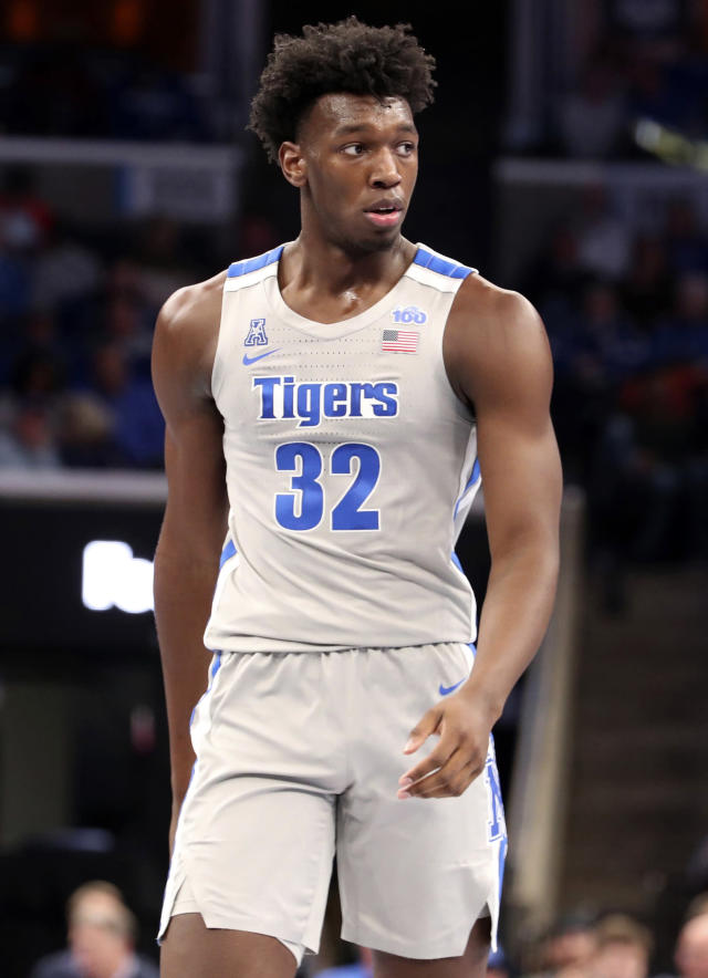 FILE - In this Saturday, Nov. 9, 2019, file photo, Memphis' James Wiseman (32) pauses between plays in an NCAA college basketball game against University of Illinois-Chicago in Memphis, Tenn. Wiseman says he has withdrawn from school as the likely NBA lottery pick gets ready to begin his pro career. (AP Photo/Karen Pulfer Focht, File)
