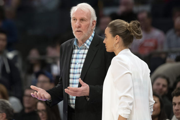 Gregg Popovich talks to Becky Hammon during a 2019 game.