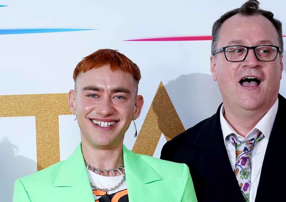 Olly Alexander and Russell T Davies were shocked to win the New Drama award for 'It's A Sin' at the National Television Awards. (PA)