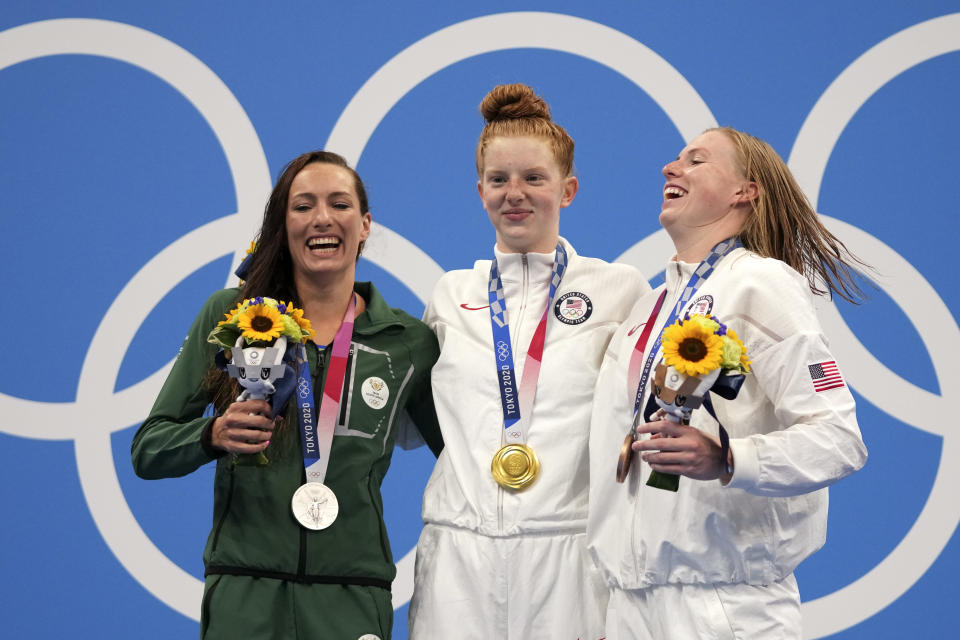 Gold medalist Lydia Jacoby, centre, of the United States, stands with silver medalist Tatjana Schoenmaker, left, of South Africa, and bronze medalist Lilly King, of the United States, after the final of the women's 100-meter breaststroke at the 2020 Summer Olympics, Tuesday, July 27, 2021, in Tokyo, Japan. (AP Photo/Matthias Schrader)