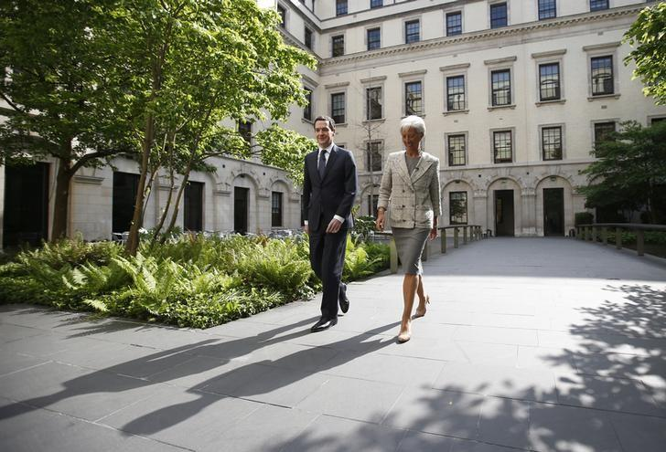 Christine Lagarde, Managing Director of the IMF meets Britain's Chancellor George Osborne, prior to a press conference, at the Treasury in London