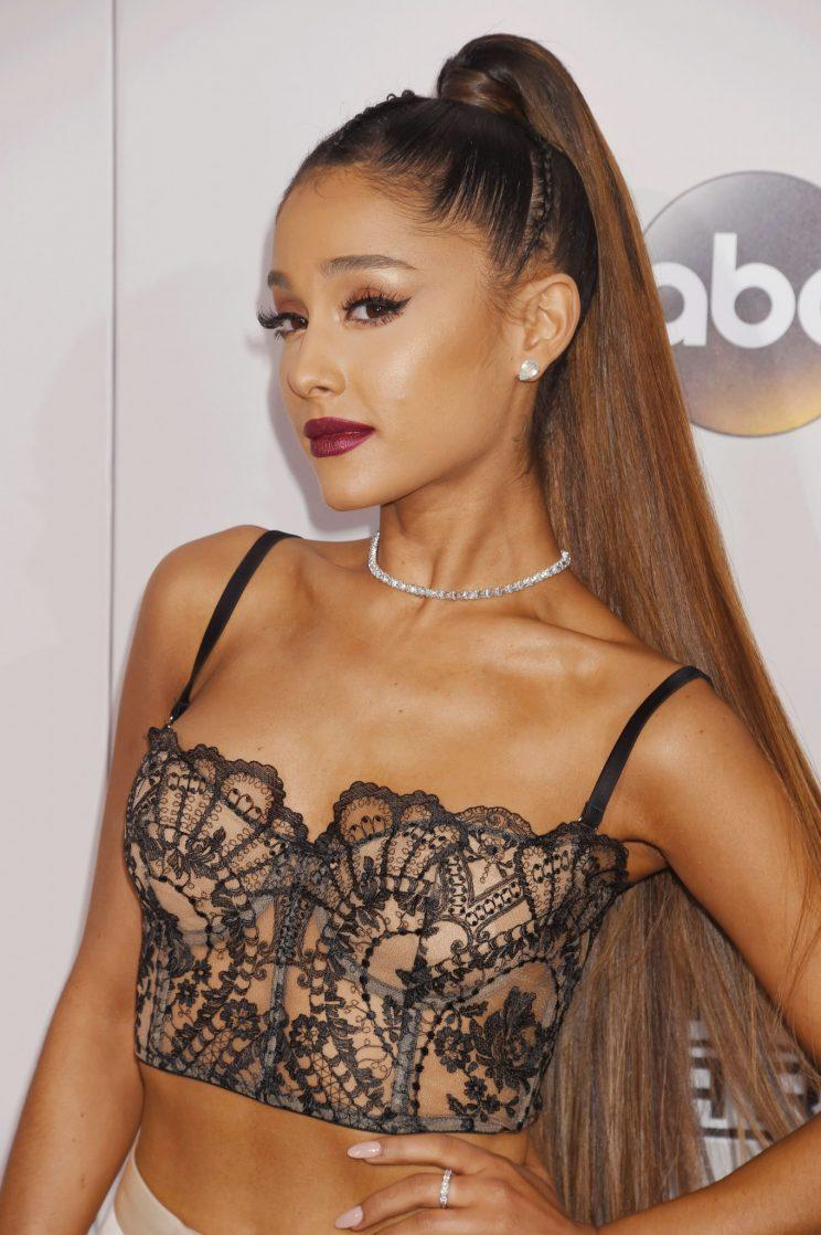 Ariana Grande with a face that says,