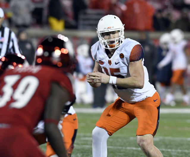 FILE - In this Nov. 18, 2017, file photo, Syracuse quarterback Rex Culpepper (15) prepares to take the snap during the second half of an NCAA college football game in Louisville, Ky. Culpepper was diagnosed with testicular cancer after spring break and underwent 100 hours of chemotherapy. In early June 2018, doctors at Moffitt Cancer Center in Tampa, Fla. told him he was cancer free. (AP Photo/Timothy D. Easley, File)