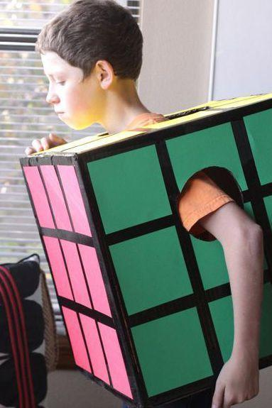 """<p>Being a square isn't always a bad thing. This brain-teaser was invented in 1974, making it a fun '70s <a href=""""https://www.countryliving.com/diy-crafts/g1360/halloween-costumes-for-kids/"""" rel=""""nofollow noopener"""" target=""""_blank"""" data-ylk=""""slk:costume for kids"""" class=""""link rapid-noclick-resp"""">costume for kids</a>.</p><p><strong>Get the tutorial at <a href=""""https://designmom.com/"""" rel=""""nofollow noopener"""" target=""""_blank"""" data-ylk=""""slk:Design Mom"""" class=""""link rapid-noclick-resp"""">Design Mom</a>.</strong></p><p><strong><a class=""""link rapid-noclick-resp"""" href=""""https://www.amazon.com/Neenah-80944-01-Astrobrights-Colored-Cardstock/dp/B01LX0UJBN/?tag=syn-yahoo-20&ascsubtag=%5Bartid%7C10050.g.22500148%5Bsrc%7Cyahoo-us"""" rel=""""nofollow noopener"""" target=""""_blank"""" data-ylk=""""slk:SHOP CARDSTOCK"""">SHOP CARDSTOCK</a></strong></p>"""