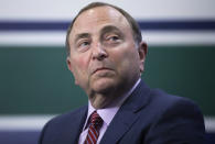 NHL Commissioner Gary Bettman listens after announcing that the 2019 NHL draft will be part of the Vancouver Canucks' 50th anniversary celebration, Wednesday, Feb. 28, 2018 in Vancouver, British Columbia. (Darryl Dyck/The Canadian Press via AP)