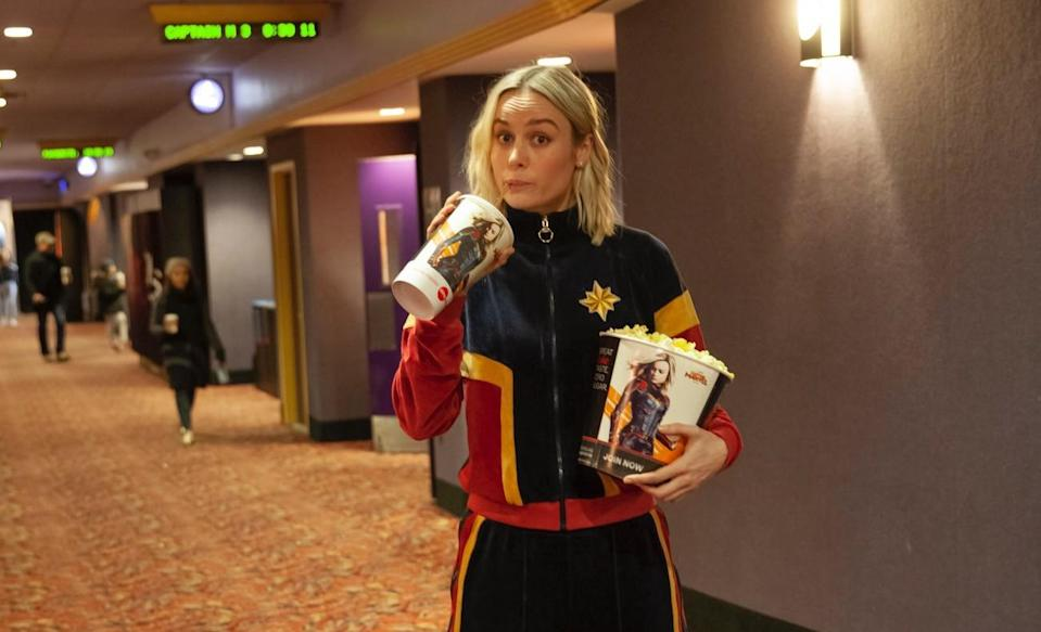 Brie Larson pops into an AMC cinema in Clifton, NJ, to watch a screening of 'Captain Marvel' with opening weekend audiences. (Credit: Twitter/@CaptainMarvel)