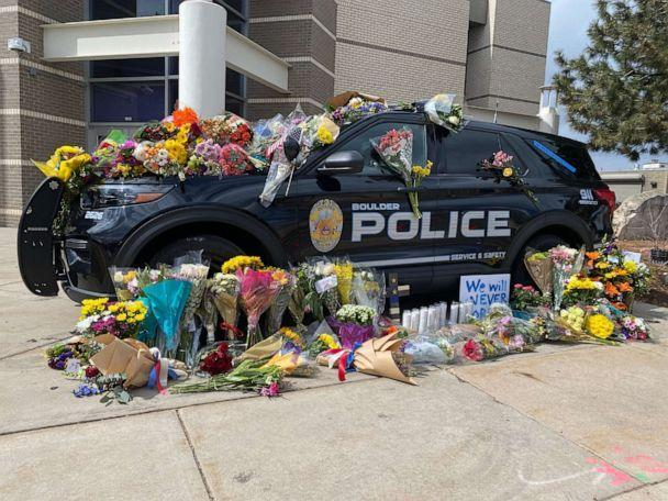 PHOTO: The police car driven by Officer Eric Talley, who was killed in a mass shooting at King Soopers grocery store in Boulder, Colo., is covered with flowers in front of the Boulder Police Department on March 23, 2021. (Will Carr/ABC News)