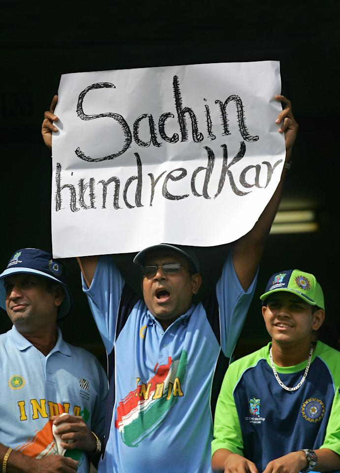Port-of-Spain, TRINIDAD AND TOBAGO: Indian cricket fans show their support for cricketer Sachin Tendulkar as India challenges Bangladesh at the Queen's Park Oval in the Port of Spain, in Trinidad and Tobago, 17 March 2007, in a group stage match of the ICC Cricket World Cup 2007. Teenager Tamim Iqbal and Mashrafe Mortaza turned giant-killers to script Bangladesh's upset five-wicket victory over India in their opening World Cup match here.  AFP PHOTO/ALESSANDRO ABBONIZIO (Photo credit should read Alessandro Abbonizio/AFP/Getty Images)
