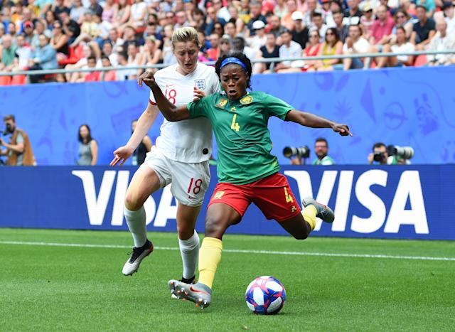 Ellen White of England battles for possession with Yvonne Leuko of Cameroon during the 2019 FIFA Women's World Cup France Round Of 16 match between England and Cameroon at Stade du Hainaut on June 23, 2019 in Valenciennes, France. (Photo by Alex Caparros - FIFA/FIFA via Getty Images)