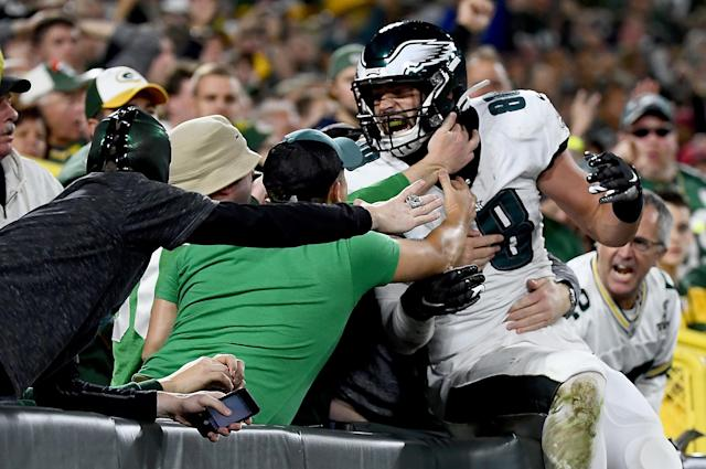 Dallas Goedert jumps into the stands after a touchdown against the Packers. (Getty Images)