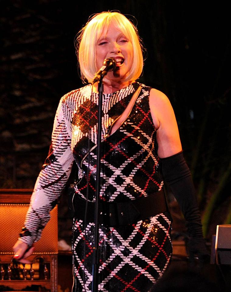 The night's other entertainer, rocker Debbie Harry, donned a wig and an odd one-shoulder ensemble as she took the stage. (10/27/2011)