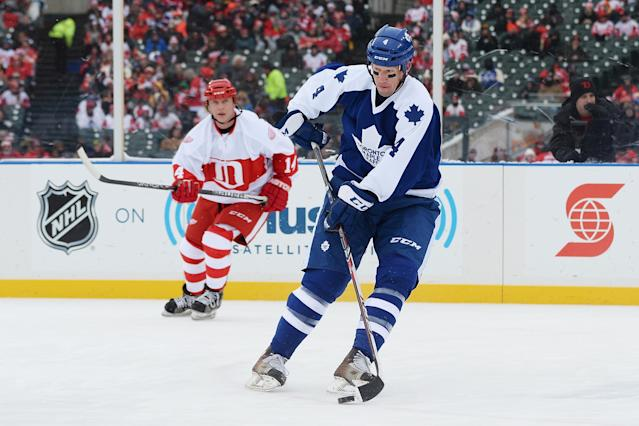 DETROIT, MI - DECEMBER 31: Cory Cross #4 of the Toronto Maple Leafs controls the puck in the first period against the Detroit Red Wings during the 2013 Hockeytown Winter Festival Alumni Showdown on December 31, 2013 at Comerica Park in Detroit, Michigan. (Photo by Jamie Sabau/Getty Images)