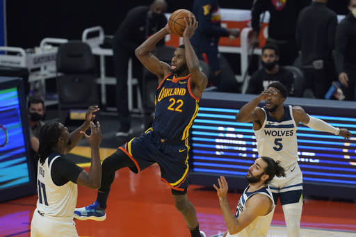 Golden State Warriors forward Andrew Wiggins (22) shoots against the Minnesota Timberwolves during the first half of an NBA basketball game in San Francisco, Monday, Jan. 25, 2021. (AP Photo/Jeff Chiu)