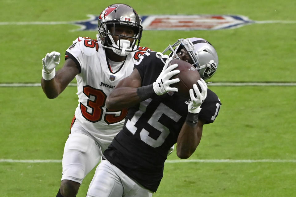 Las Vegas Raiders wide receiver Nelson Agholor (15) catches a pass over Tampa Bay Buccaneers cornerback Jamel Dean (35) during the second half of an NFL football game, Sunday, Oct. 25, 2020, in Las Vegas. (AP Photo/David Becker)