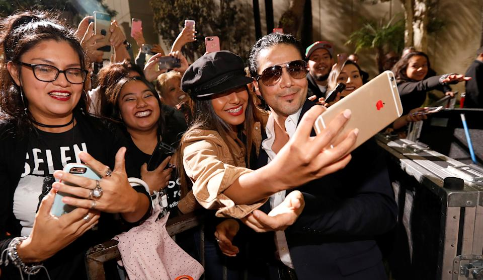Chris Perez poses with fans after unveiling the star of late singer Selena Quintanilla-Perez on the Hollywood Walk of Fame in Los Angeles, California, U.S., November 3, 2017. REUTERS/Mario Anzuoni