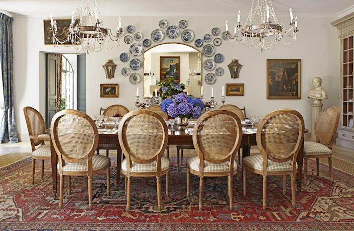 """<p>Skip the traditional gallery wall and let those one-of-a-kind plates and pottery pieces from your prized collection take center stage. Designer <a href=""""https://www.sblonginteriors.com/"""" rel=""""nofollow noopener"""" target=""""_blank"""" data-ylk=""""slk:Susan Bednar Long"""" class=""""link rapid-noclick-resp"""">Susan Bednar Long </a> cleverly mounted a collection of antique Delftware and faience pottery as wall decor in this <a href=""""https://www.veranda.com/decorating-ideas/a26976859/provence-farmhouse-transforms-beautiful-gardens/"""" rel=""""nofollow noopener"""" target=""""_blank"""" data-ylk=""""slk:farmhouse dining room"""" class=""""link rapid-noclick-resp"""">farmhouse dining room</a> in Provençe, France. </p>"""