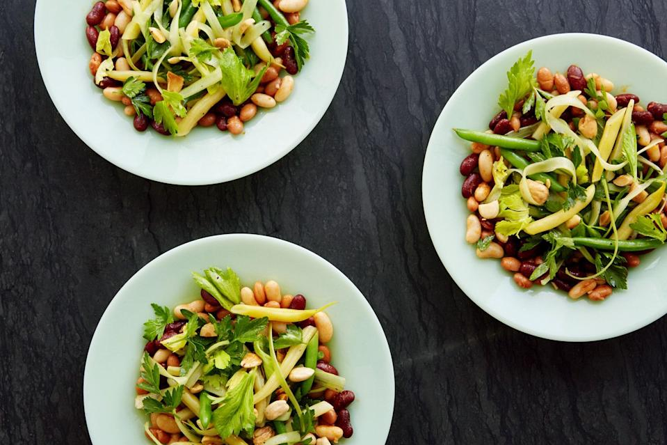 "Bean salad is famous for being portable, not necessarily for being flavorful—until now. This fresh, summery version features smoky paprika and crunchy Marcona almonds, balanced by the bright freshness of parsley and celery. <a href=""https://www.epicurious.com/recipes/food/views/five-bean-salad-with-smoked-paprika-vinaigrette-56389686?mbid=synd_yahoo_rss"" rel=""nofollow noopener"" target=""_blank"" data-ylk=""slk:See recipe."" class=""link rapid-noclick-resp"">See recipe.</a>"