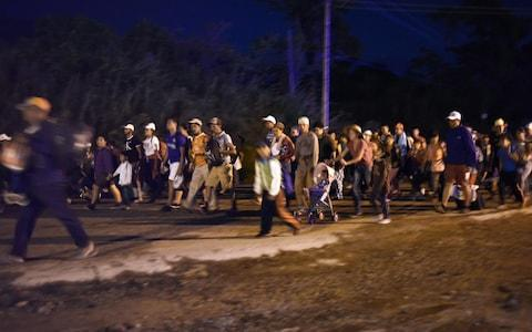 <span>The migrant caravan, pictured passing through Huixtla, southern Mexico, on Wednesday</span>