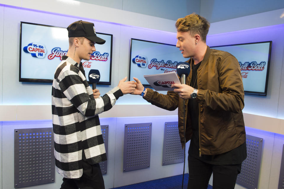 Justin Bieber pictured with Roman Kemp during the Capital FM Jingle Bell Ball 2015 at the O2 Arena, London. (Credit: PA)