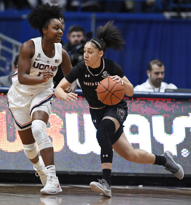 South Carolina's Bianca Cuevas-Moore, right, dribbles as Connecticut's Christyn Williams defends, during the first half of an NCAA college basketball game, Monday, Feb. 11, 2019, in Hartford, Conn. (AP Photo/Jessica Hill)
