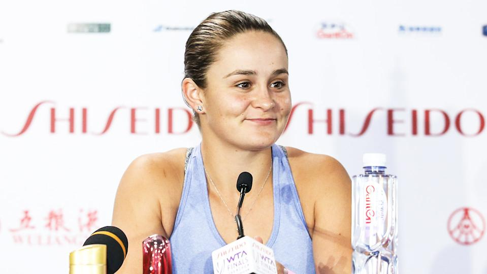 Ash Barty (pictured) smiles during a press conference.