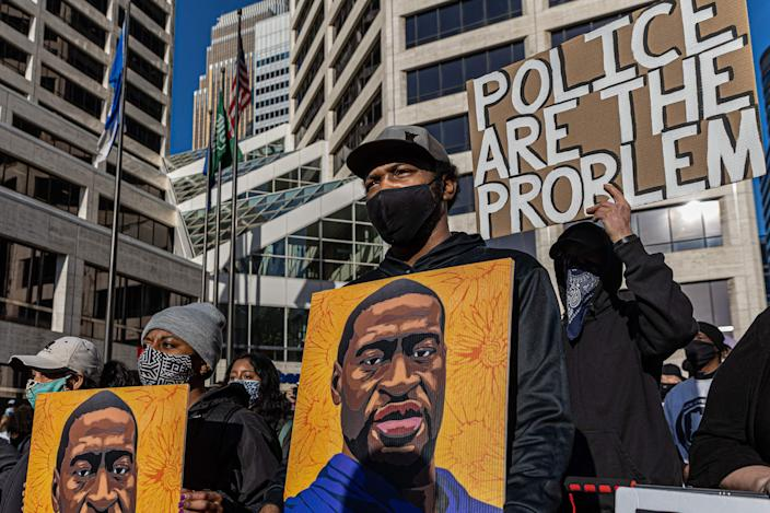 Demonstrators protest outside the Hennepin County Government Center before jury selection begins at the trial of former Minneapolis Police officer Derek Chauvin on March 8, 2021 in Minneapolis, Minn.