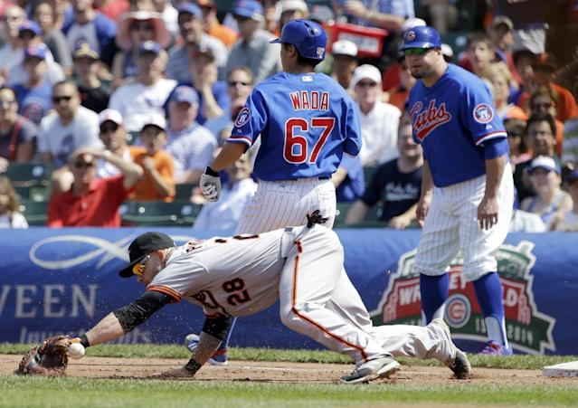 Chicago Cubs' Tsuyoshi Wada (67), of Japan, is safe at first after hitting a single as Baltimore Orioles first baseman Steve Pearce misses the catch during the third inning of an interleague baseball game in Chicago, Sunday, Aug. 24, 2014. (AP Photo/Nam Y. Huh)