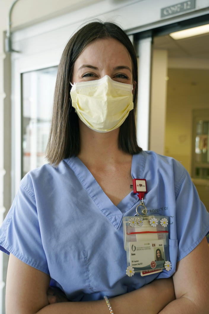 Anne Sinclair, a pediatric emergency room nurse at the University of Mississippi Medical Center, in Jackson, wonders why some incoming patients and their parents have to be reminded to wear masks when they come to the hospital, Wednesday, Aug. 25, 2021. A mother of two young children, Sinclair is tired of the covid misinformation she deals with having seen children in her unit die of the virus. (AP Photo/Rogelio V. Solis)