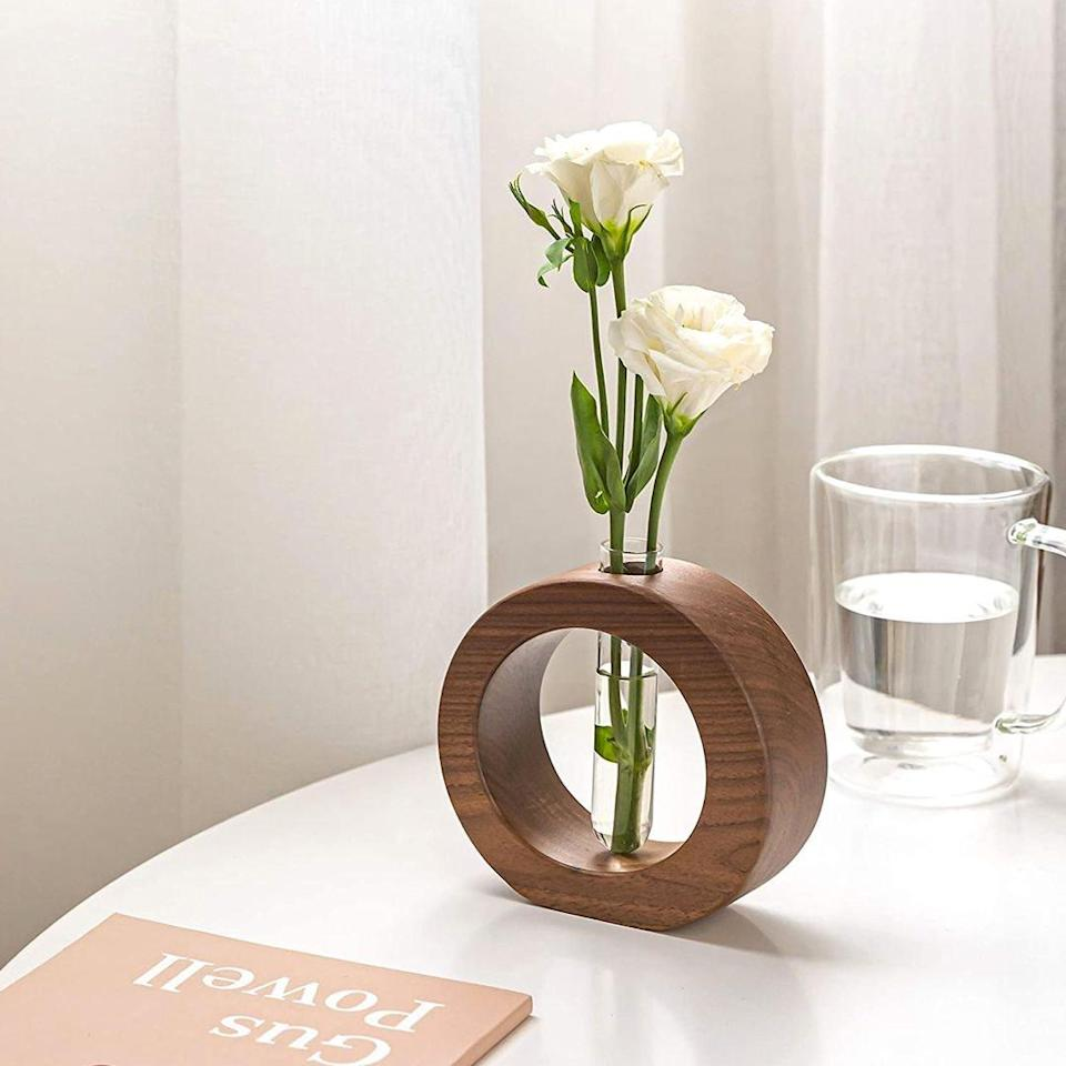 """If you have one thriving plant, it's simpler than expected to grow more. Just snip a stem or two from one of your green babies and place it in this stylish propagation vase, which is chic, functional, and under $20. Okay, Amazon, we see you. $20, Amazon. <a href=""""https://www.amazon.com/Propagation-Planter-Hydroponics-Decorative-Gardening/dp/B0893V82RG/"""" rel=""""nofollow noopener"""" target=""""_blank"""" data-ylk=""""slk:Get it now!"""" class=""""link rapid-noclick-resp"""">Get it now!</a>"""