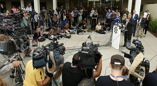 Lt. Keith Boyd, assistant chief deputy coroner for the Marin County Sheriff's Office, at podium, speaks at a packed news conference about the death of Robin Williams in San Rafael, California. Photo: AP.