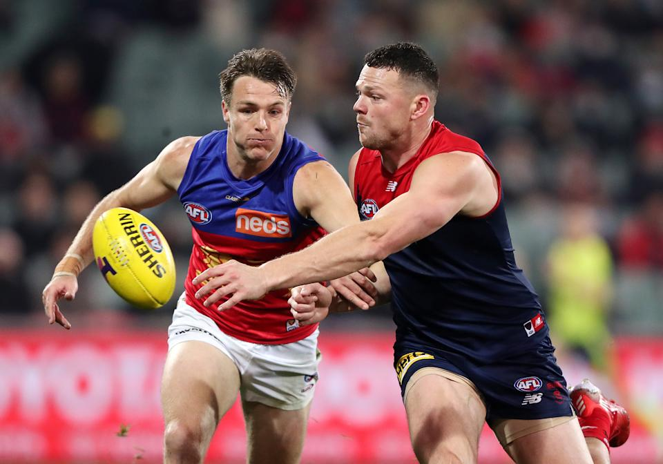 ADELAIDE, AUSTRALIA - AUGUST 28: Lincoln McCarthy of the Lions and Steven May of the Demons during the 2021 AFL First Qualifying Final match between the Melbourne Demons and the Brisbane Lions at Adelaide Oval on August 28, 2021 in Adelaide, Australia. (Photo by Sarah Reed/AFL Photos via Getty Images)
