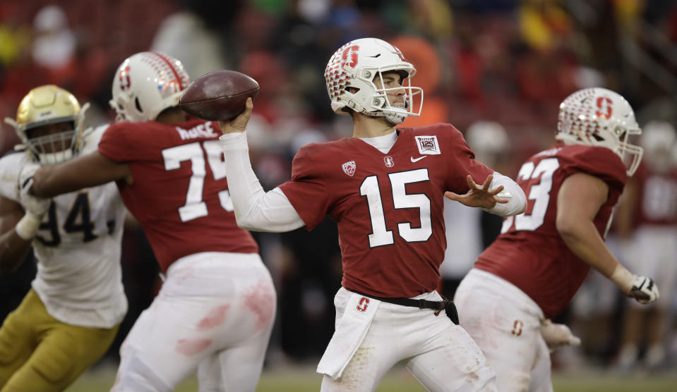 Stanford quarterback Davis Mills (15) passes against Notre Dame in the second half of an NCAA college football game Saturday, Nov. 30, 2019, in Stanford, Calif. (AP Photo/Ben Margot)