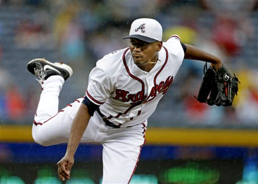 Atlanta Braves starting pitcher Julio Teheran throws in the first inning of a baseball game against the Miami Marlins, Thursday, July 4, 2013, in Atlanta. (AP Photo/David Goldman)