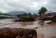 Damaged houses are seen at an area affected by flash floods after heavy rains in East Flores, East Nusa Tenggara province, Indonesia April 4, 2021 in this photo distributed by Antara Foto